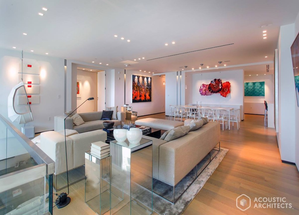A temperature-controlled living room, with an ambiance you'll never want to leave featuring Lutron Electronics, Savant Home temperature control and Sonance speakers.